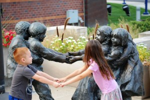 My grandkids emulate the statue at Indy Children's Museum