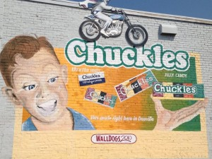 Chuckles Ad with Evel Knievel flying over it....