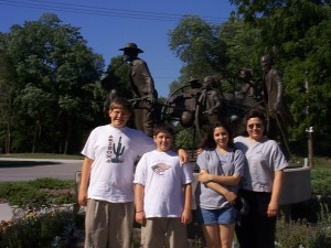 Seth, Solomon, Marissa and Julianne at Winter Quarters monument at Mormon Trail Center in Omaha, Nebraska, Summer 1999
