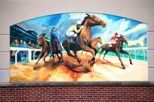 Horse Racing mural at Whittaker Bank Ballpark by Esteban Camacho Steffensen