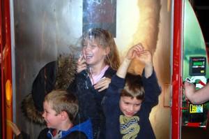 Kade, Charlie and cousin Autumn in the vacuum at Louisville Children's Museum - Dec. 2012