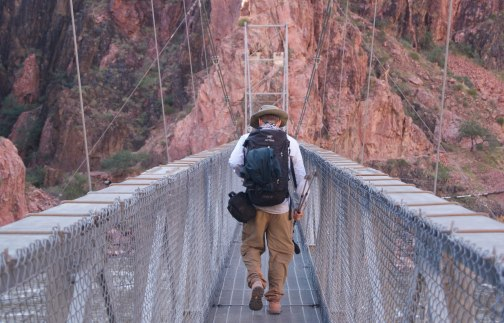 Padre in Adventure Pants crossing the Colorado River in the Grand Canyon