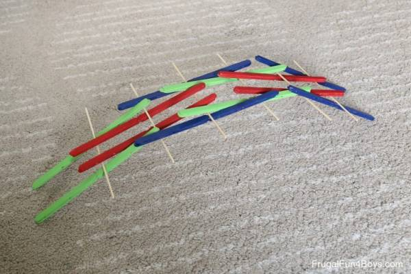 make a da vinci bridge with craft sticks and skewers