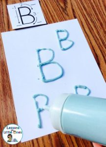 writing alphabet letters using salt puffy paint