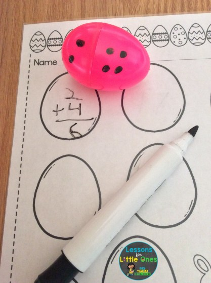 math center with plastic eggs addition practice