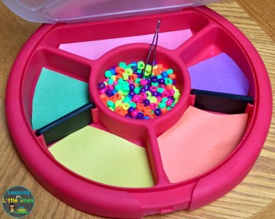 color sorting tray with pony beads and tweezers