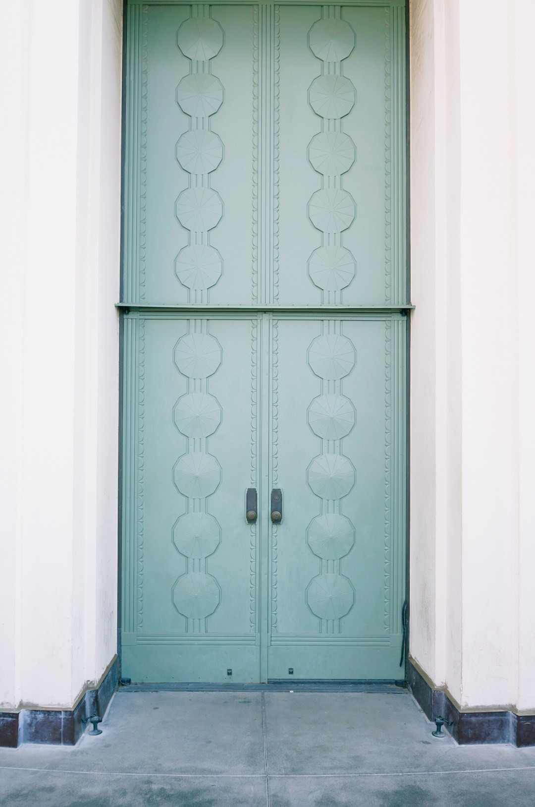 seafoam green doors with art deco details at griffith observatory