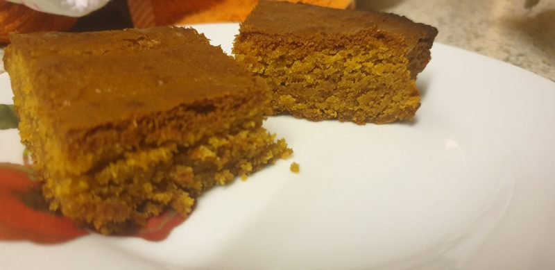 A couple of Blondie squares on a plate.