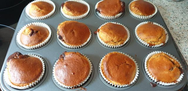 A muffin tray full of freshly cooked muffins