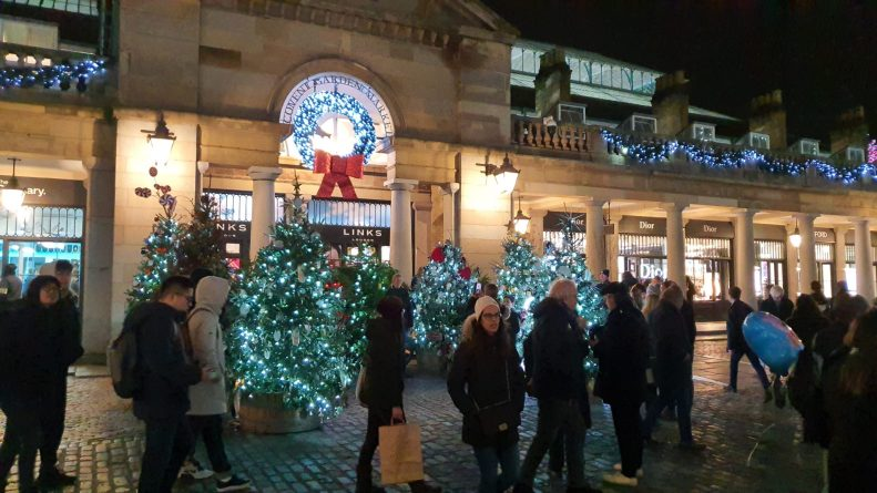 Trees and crowds in Covent garden - Christmas 2019