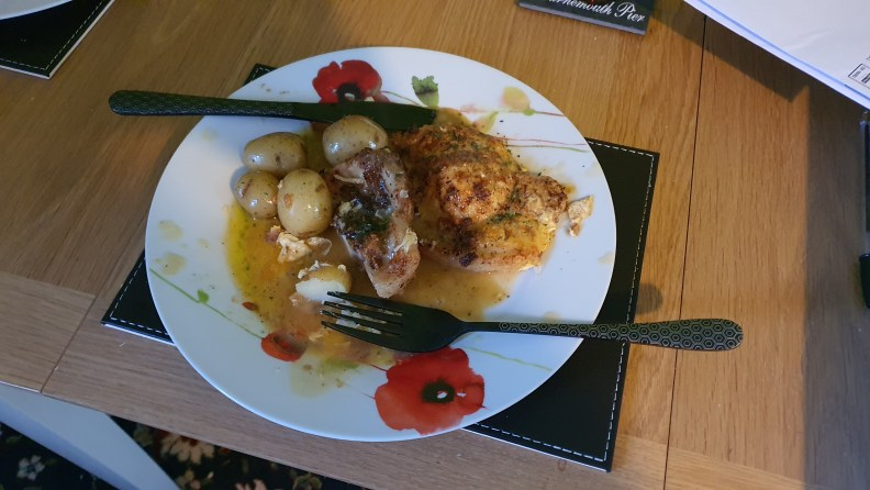 A plate of pork chops romano