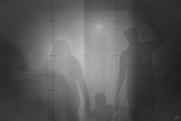 Shadow of family including child holding hands