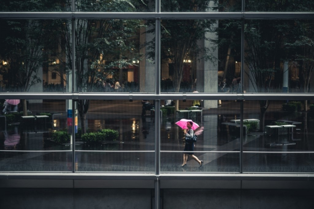 Photo of woman with pink umbrella