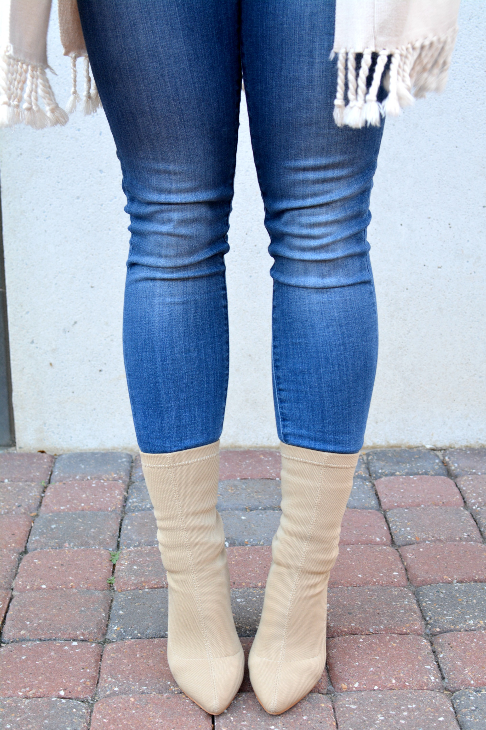 Ashley from LSR in skinny jeans and nude sock boots
