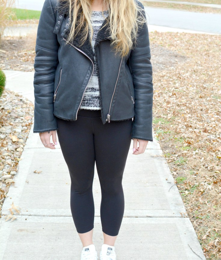Ashley from LSR in a shearling jacket, Alo leggings, and Adidas sneakers