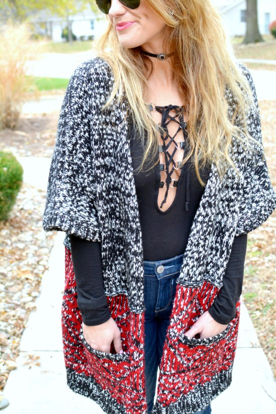 Ashley from LSR in a long cardigan and a lace-up bodysuit