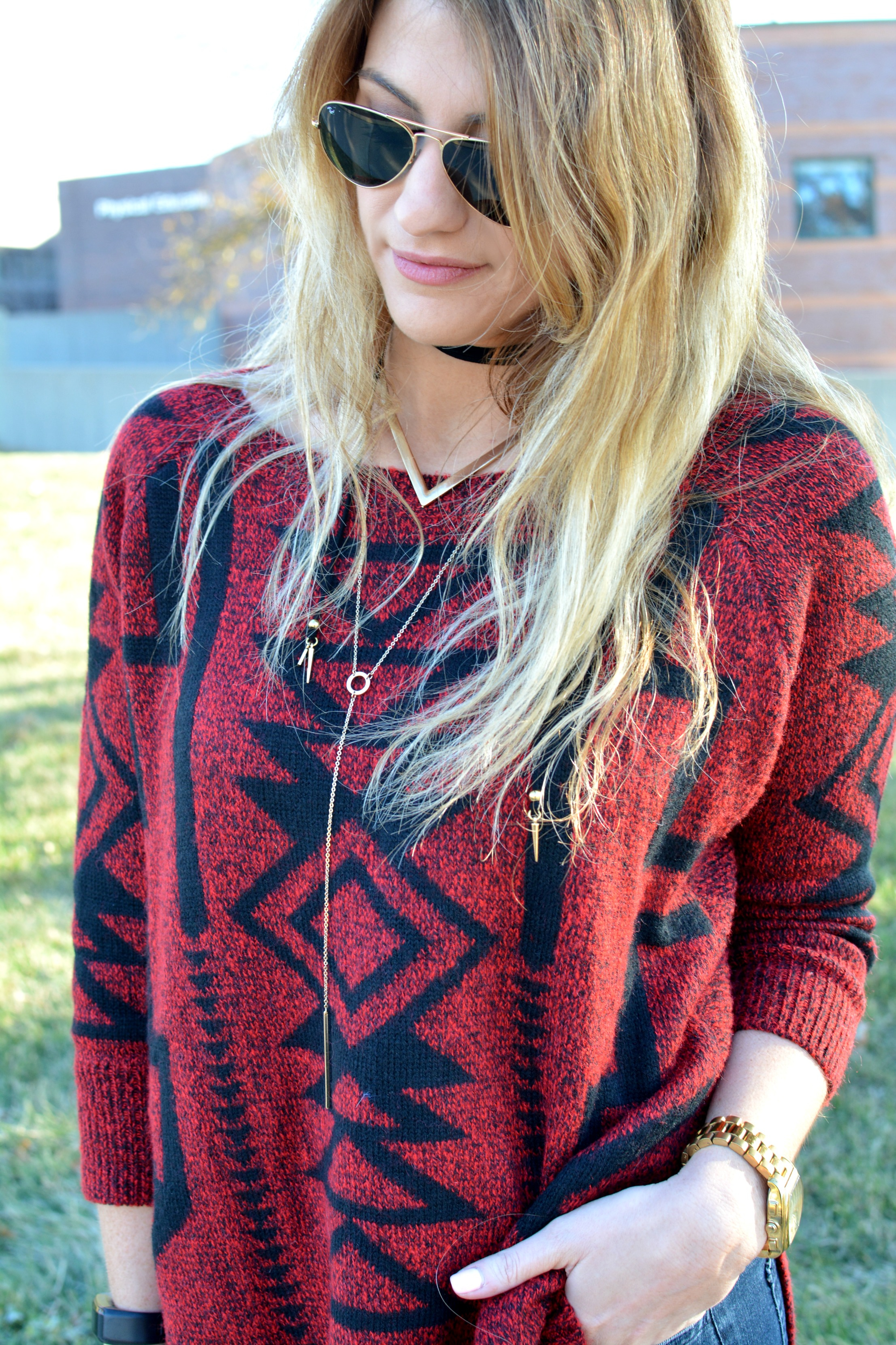 Ashley from LSR in a red and black sweater with a Vanessa Mooney choker