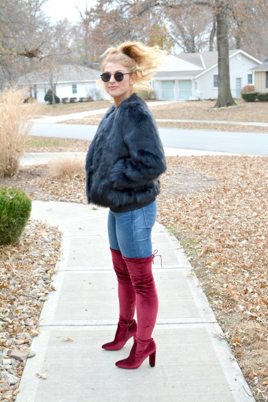 Ashley from LSR in a navy faux fur coat and burgundy thigh high boots