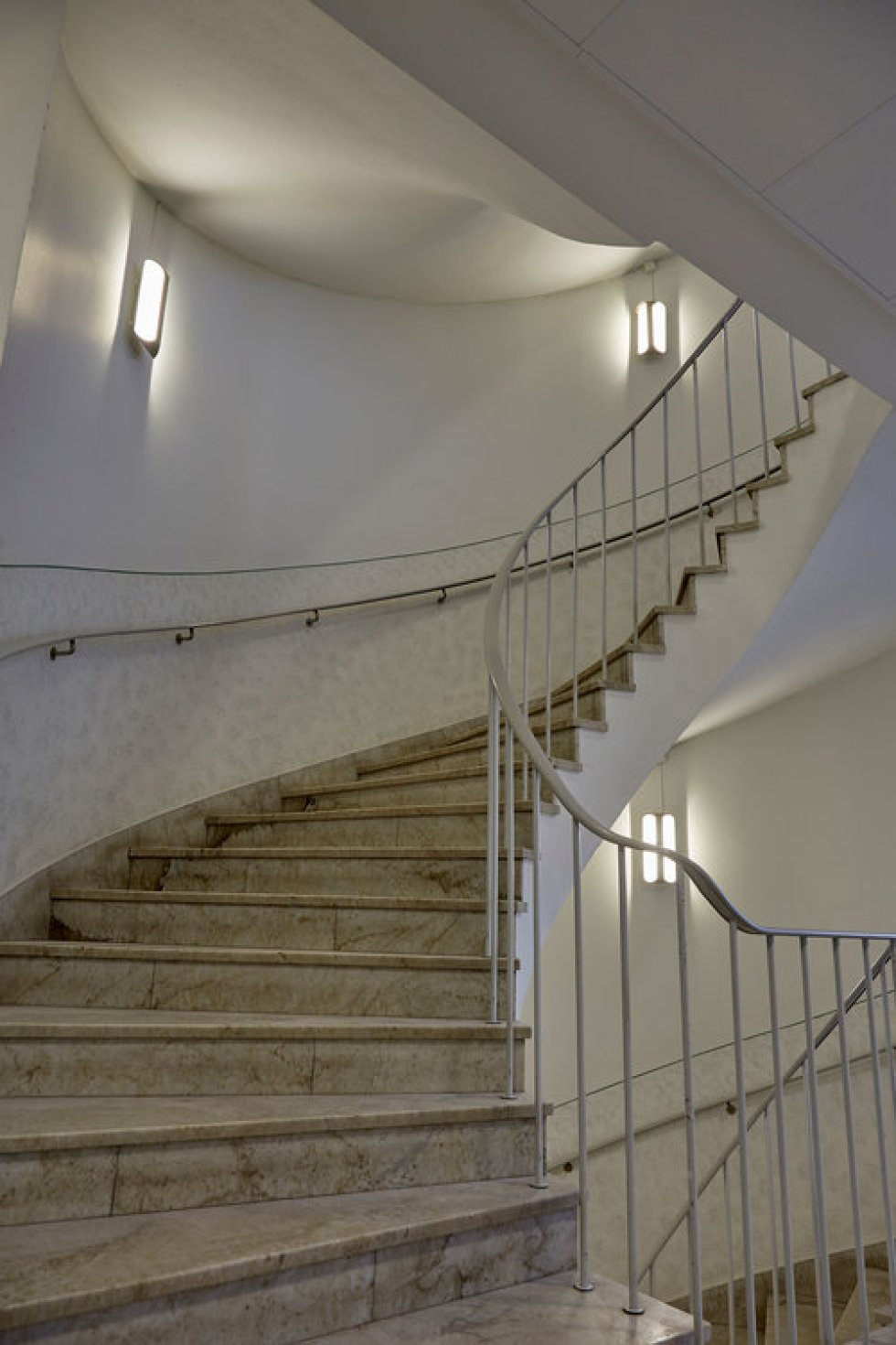 staircase with clark wall fixtures
