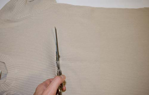 Sofa Bow Pillow From a Man's Sweater - Step-by-step sewing tutorial with clear photographs and instructions. Upcycle a sweater, and refashion clothes into this cute home decoration. A great, low-cost way to change up your home accessories for each season, or just style your home on the cheap. Remake, redo, reuse, and recycle to help save money and save the planet. Explore the web site for more refashioning tutorials, dozens of cute refashionista and fashion ideas. http://letgoofbeingperfect.com