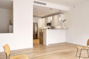 Las cocinas abiertas incluyen un refrigerador Energy Star Electrolux y cocina de inducción