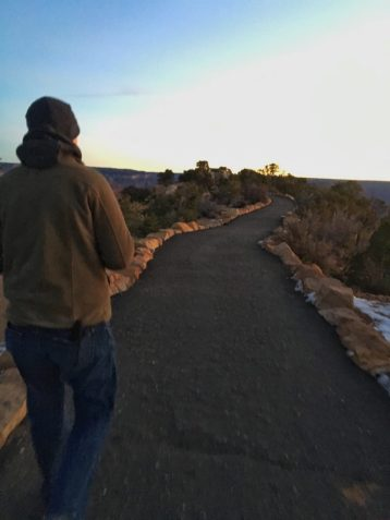 Eric walking towards the lookout point at the Grand Canyon at Sunrise