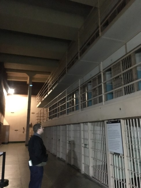 Eric standing in front of a cell at Alcatraz