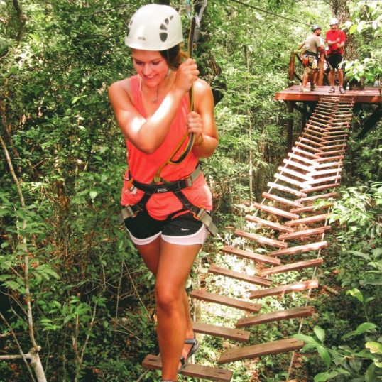 Lauryn walking on the ropes course in the jungle near Tulum, Mexico