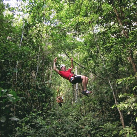 Eric zip lining in Tulum, Mexico
