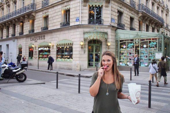 Eating macarons from Laduree in Paris France