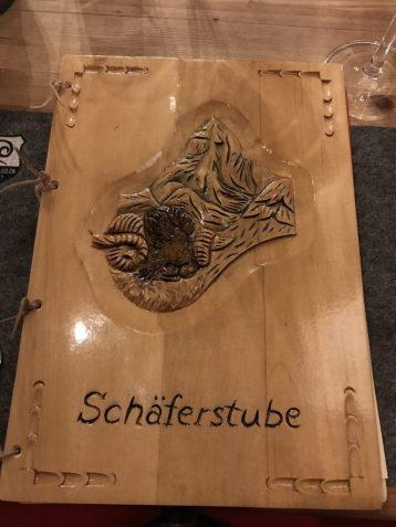 Unique wooden menu at Restaurant Schaferstube in Zermatt Switzerland
