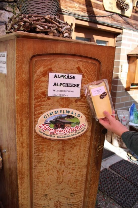 Buying cheese from a farm in Gimmelwald Switzerland