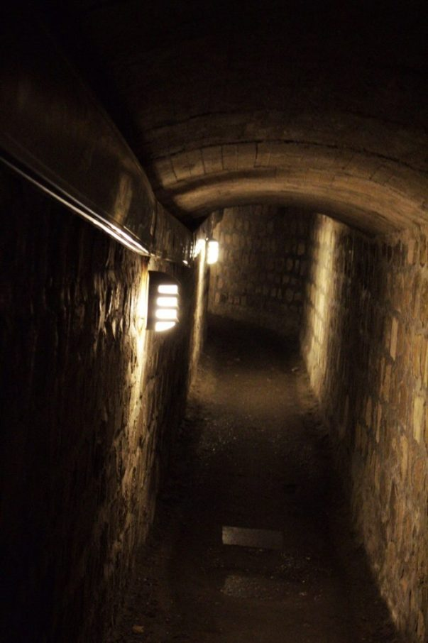 Walking down into the Catacombs of Paris France