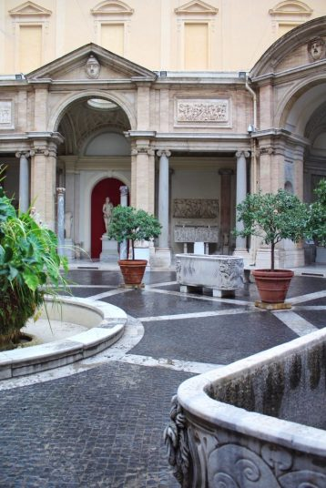 Courtyard with sculptures at the Vatican Museum in Rome Italy