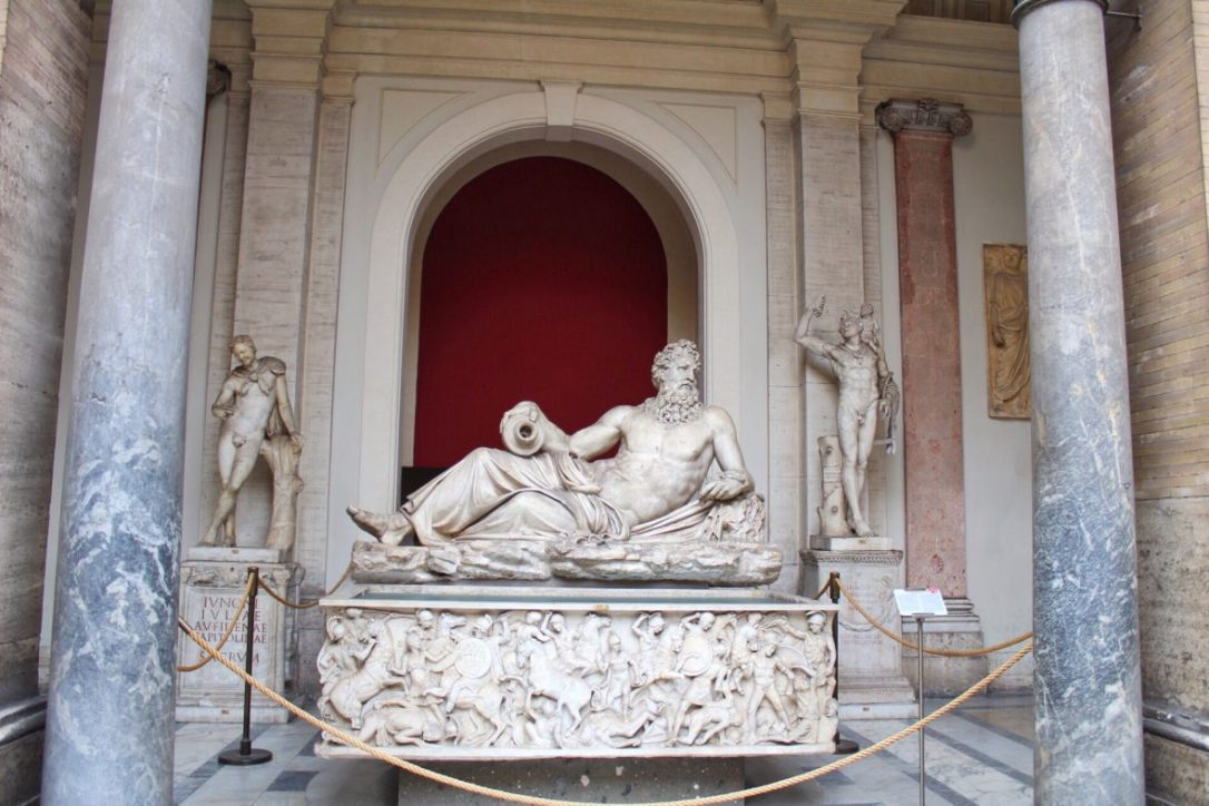 Statue of River god (Arno) inside Vatican museum in Rome Italy