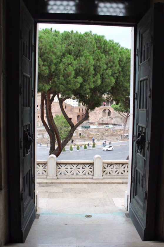 Looking outside of the doors of the Altare della Patria in Rome Italy