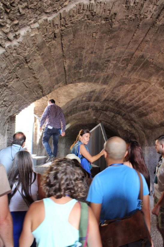 Walking around the top level of the Colosseum in Rome Italy