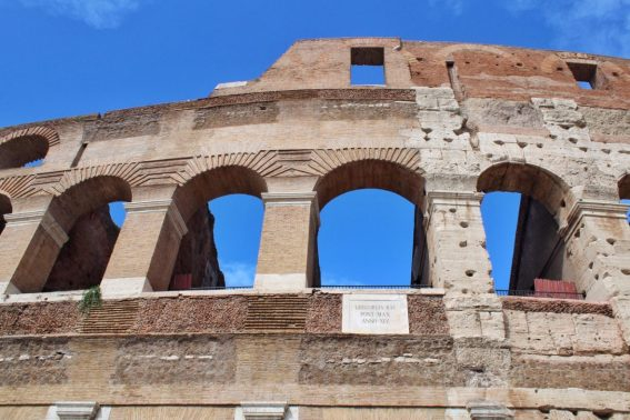 The outside walls of the Colosseum in Rome Italy
