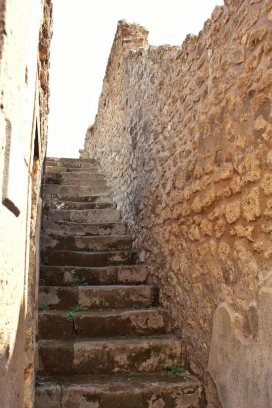 Stairs inside the ruined city of Pompeii in Italy