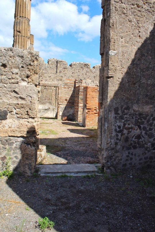 Looking in to a home Inside the ruined city of Pompeii Italy