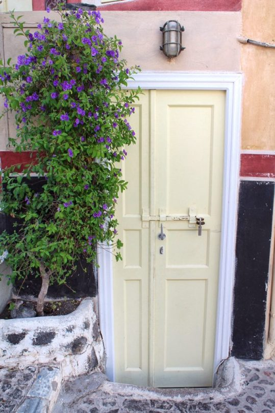 Pretty door with flowers in Oia, Santorini