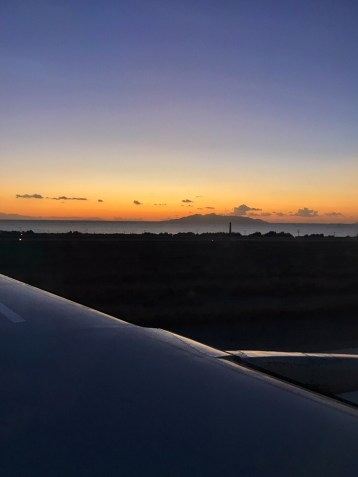 View of the sunrise from the plane on Santorini