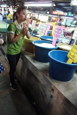 Wass showing us different types of rice in the market