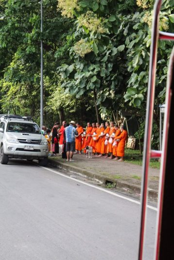 Local monks receiving Alms in Chiang Mai on our way to Wat Phra That Doi Suthep Chiang Mai
