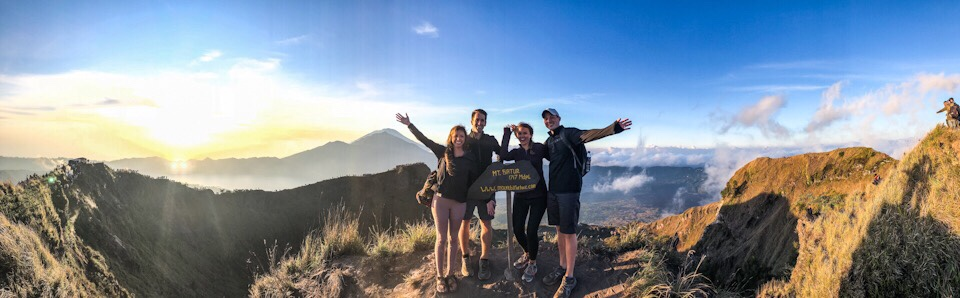 Panorama of Lauryn, Eric, Kristi, and Kevin with the Mount Batur elevation sign