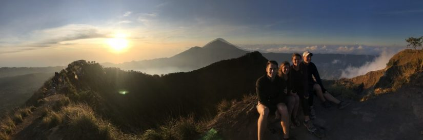 Panorama of Lauryn, Eric, Kristi, and Kevin on top of Mount Batur with the sunrise in the background