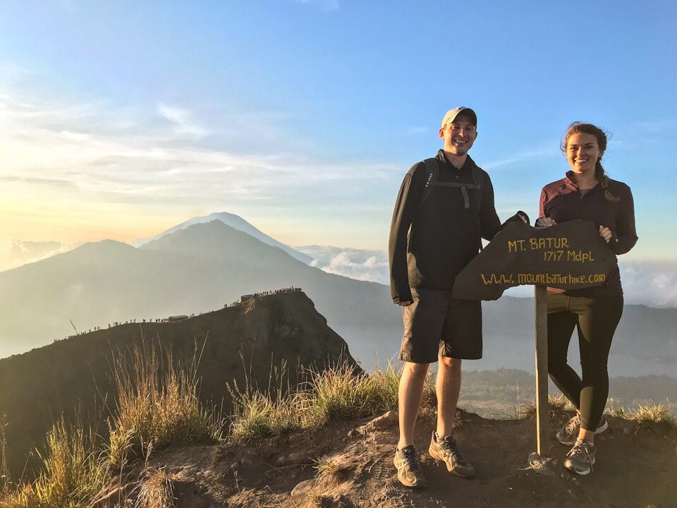 Lauryn and Eric with the Mount Batur elevation sign