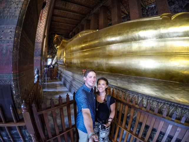 Lauryn and Eric in front of the reclining Buddha at Wat Pho in Bangkok