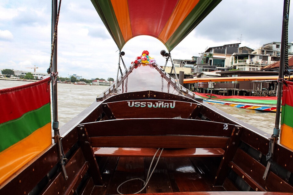 Riding in a longtail boat in Bangkok Thailand