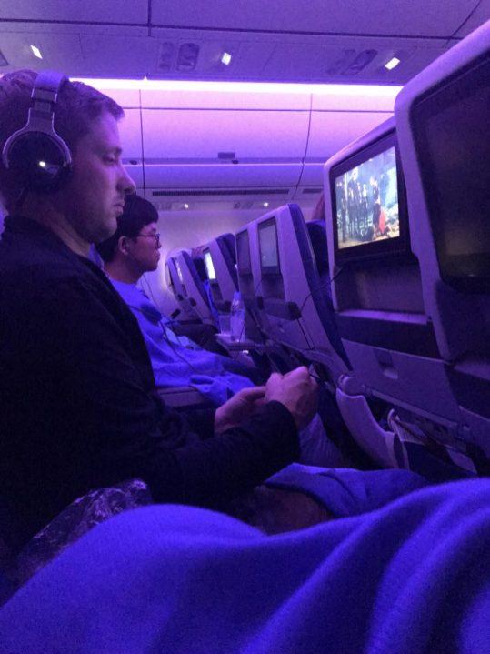 During the flight traveling from Bangkok to Atlanta
